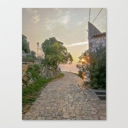 Little alley in the medieval center of the village Rovinji at sunset Canvas Print