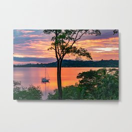 Sailboat Anchored In Calm Water with Colorful Sunset Metal Print