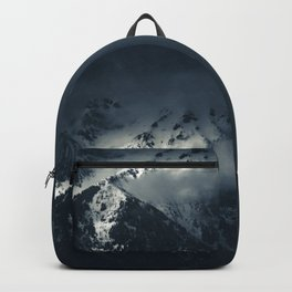 Darkness and clouds over the mountains Backpack