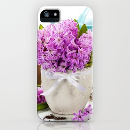 Beautiful Hyacinths in vase and garden tools over white iPhone Case
