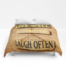 LIVE WELL. LOVE MUCH. LAUGH OFTEN. Comforters