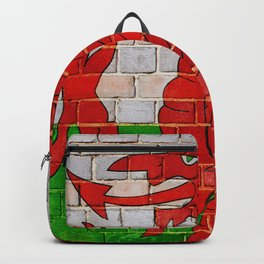 Wales flag on a brick wall Backpack