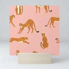 Cheetahs pattern on pink Mini Art Print