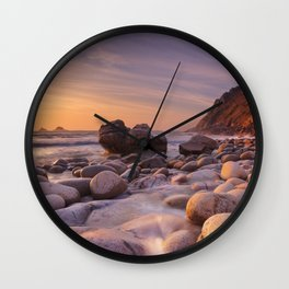 Rocky beach at sunset, Porth Nanven, Cornwall, England Wall Clock