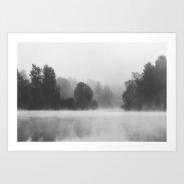 Trees disappearing in morning fog above the lake Art Print