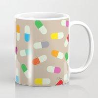 the cure Mugs featuring Pill cure by  R U A L E G R E