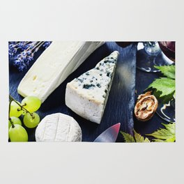 Food background with Wine, cheese and Grape. Rug