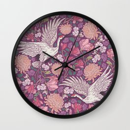 Cranes with chrysanthemums and pink magnolia on purple background Wall Clock