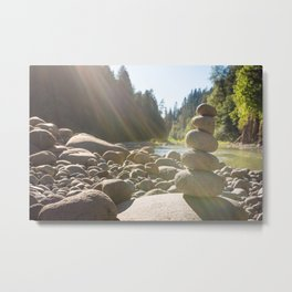 Cairn of stacked rocks along banks of Oregon river Metal Print