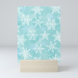 blue winter background with white snowflakes Mini Art Print