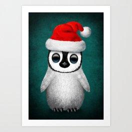Baby Penguin Wearing a Santa Hat on Blue Art Print