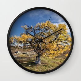 Yellow Tree in the mountains Wall Clock