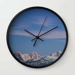 Last light on snowy mountain peaks. Wall Clock