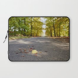 Remote country road through Autumnal woodland. Norfolk, UK. Laptop Sleeve