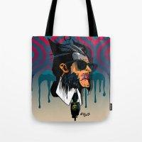 karl lagerfeld Tote Bags featuring wolvereen  vs Karl Lagerfeld  by el brujo