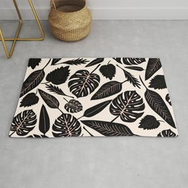 Monstera pattern in black and pastel Rug