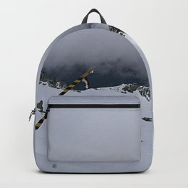 White snow and grey clouds Backpack