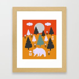 Bear walking between flowers and pine trees Framed Art Print