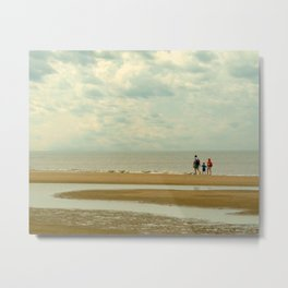Walkers on the beach Metal Print