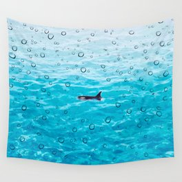 Orca Whale gliding through the water on a rainy day Wall Tapestry
