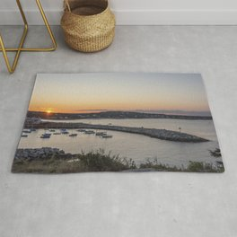 Breakwater in Rockport at sunset Rug