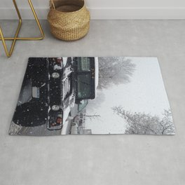 Car in the snow Rug