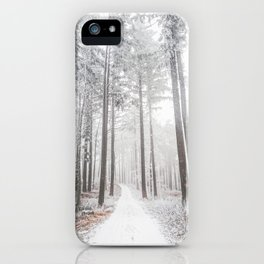Mysterious road in a frozen foggy forest iPhone Case