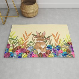 Bunny in garden with colored Easter eggs Rug