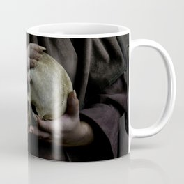 Holding a male skull Coffee Mug
