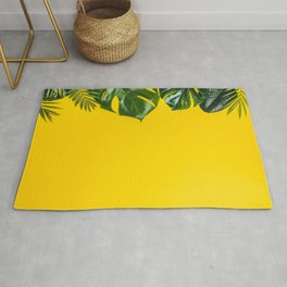 Tropical leaves on yellow background, space for text Rug