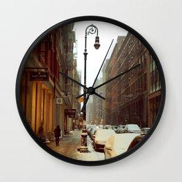 Soho snowing. Winter in New York Wall Clock