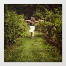 Young woman running through a vineyard Canvas Print