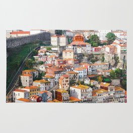 Traditional Porto houses, with Guindais Funicular and the Fernandina Wall to the left. Rug