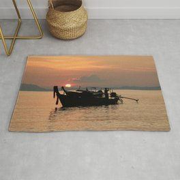 Long-tail boat at sunset in Thailand Rug