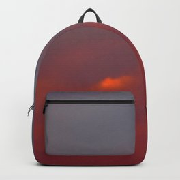 Red cloud shining at sunset Backpack