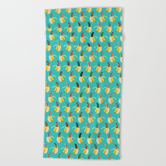 Anna Banana on blue Beach Towel