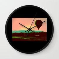 hot air balloon Wall Clocks featuring Hot Air Balloon by Derek Fleener