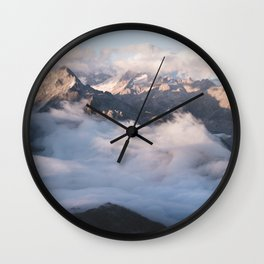 Up above the alpine sea of clouds Wall Clock