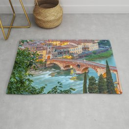 Panoramic view of Ponte Pietra, Verona and its Roman Architecture - A classic present for travel addicted that loves Italy, its architecture, and the city of Romeo and Juliet Rug