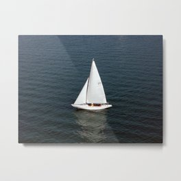 Boat on the waves Metal Print