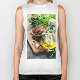 fresh  herbs  with  mezzaluna, olive oil and vegetables on cutting board Biker Tank