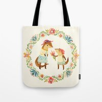 otters Tote Bags featuring Otterly Grateful by Teagan White