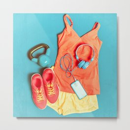 Fitness at gym activewear workout clothes with kettlebell listening to music on phone Metal Print