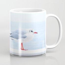 White bird at the beach Coffee Mug