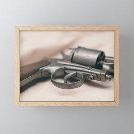 Ancient revolver. Old gun. Framed Mini Art Print