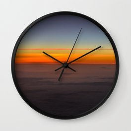 Sunrise over clouds Wall Clock