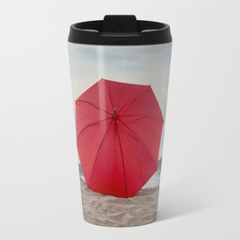 Red umbrella lying at the beach Travel Mug