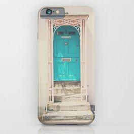 mint green door in a pink building  iPhone Case