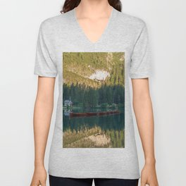 Row of wooden boats in front of a church reflected in the water Unisex V-Neck