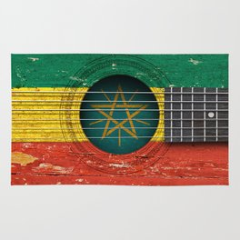 Old Vintage Acoustic Guitar with Ethiopian Flag Rug